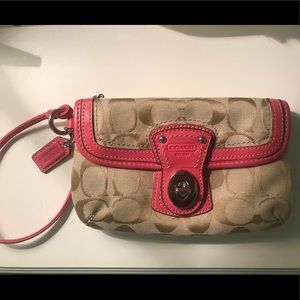 Coach wristlet with pink lining